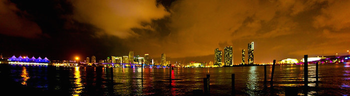 Miami Beach at night, city lights in background
