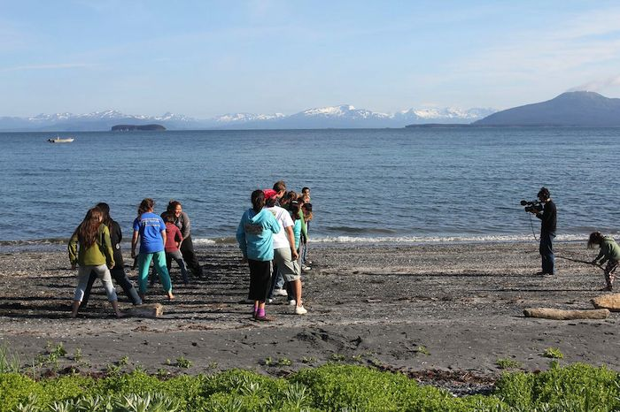 A group of people standing on a Kodiak Island beach.