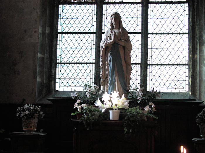 A Virgin Mary Statue in a windowsill