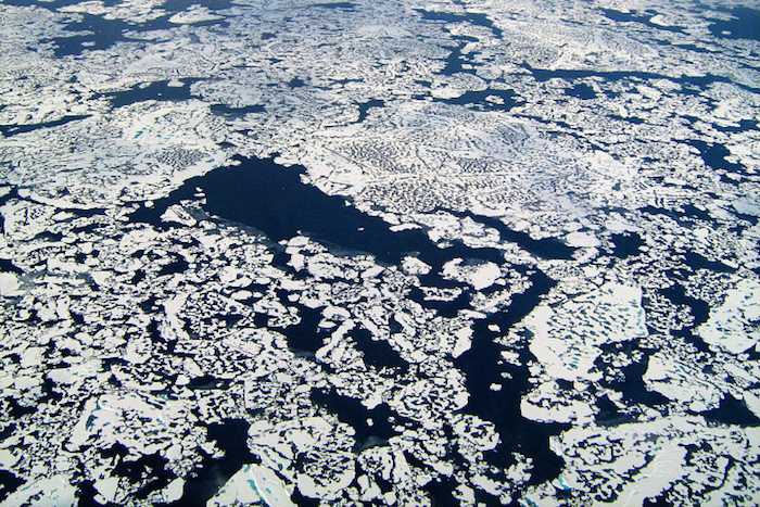 Methane bubbling up through arctic ice
