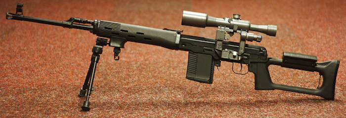 High-powered hunting rifle with scope