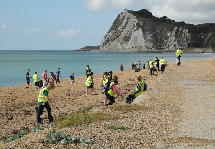 A group picking up litter from Shakespeare Beach