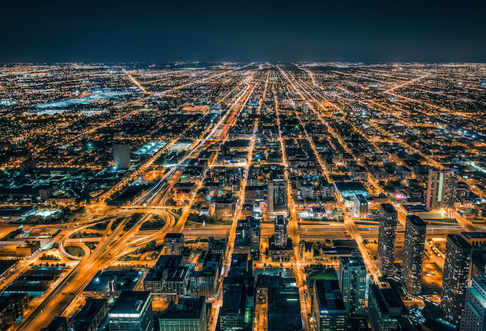 Overhead view of Chicago at night, intricate paths of light.
