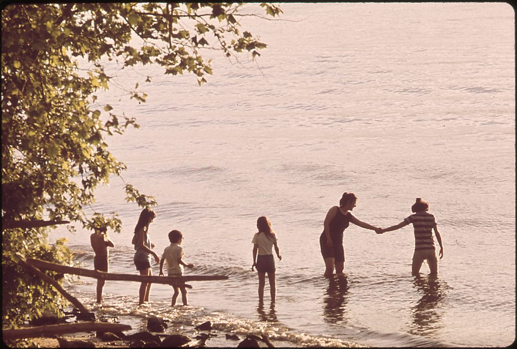 Family playing on the bank of the Ohio river